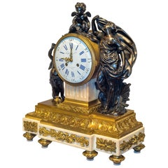 19th Century Louis XVI Gilt and Patinated Bronze Figural Mantel Clock