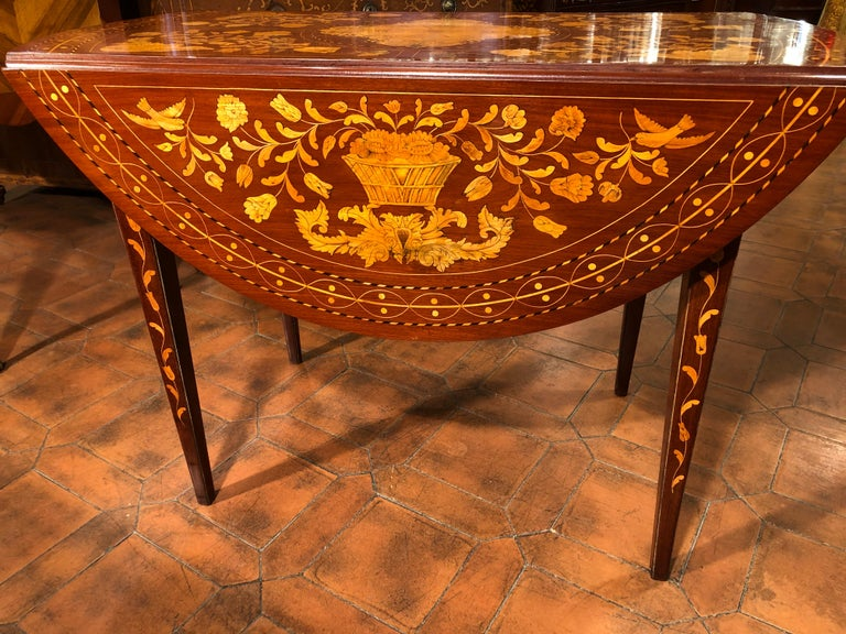 Sofa table from the Netherlands, in full Dutch style in tarsia, famous throughout Europe. It is thought that the Holland produced furniture of different shapes and inlays according to the country that ordered the furniture. This Sofa Table was for