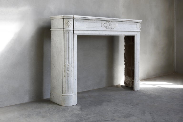 Beautiful antique Carrara marble fireplace in the style of Louis XVI, demi-luna. We have dismantled this fireplace from a beautiful apartment in Paris. A fireplace with a look, history and elegance from the 19th century.