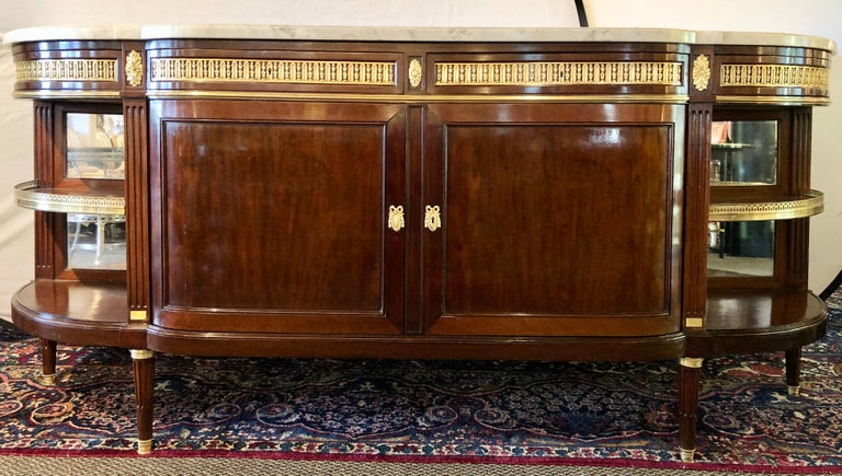 19th century Louis XVI sideboard, cabinet or console by Maison Forest. This finely constructed mahogany cabinet by this highly regarded cabinet maker has a thick white marble top supported by a monumental case of double doors under four drawers with