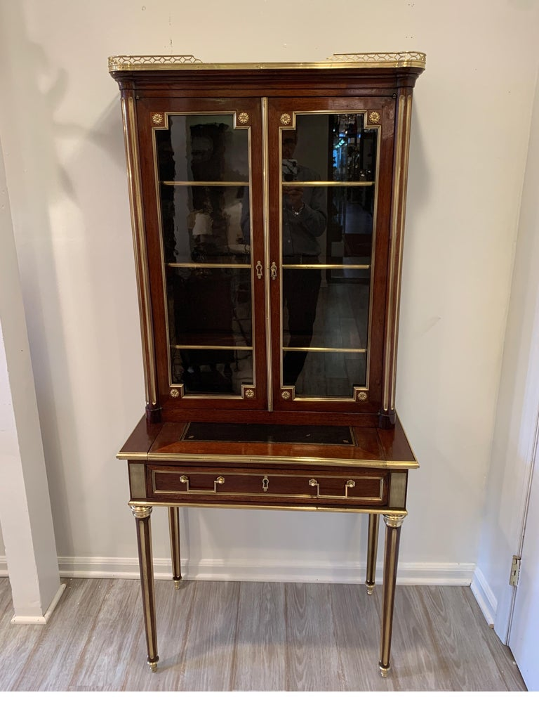 19th century Louis XVI style diminutive two part bookcase on desk/secretary Beautifully restored and polished, ready to go place in home. Measures: 65.5