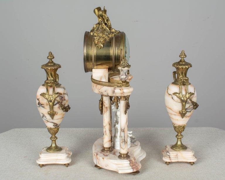 Bronze 19th Century Louis XVI Style French Mantel Clock Garniture For Sale