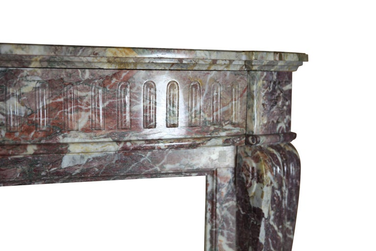 This fireplace surround is from a paneled salon in Antwerp. The color of the marble is exceptional and distinctive. Perfect for a Fine Classic French or European styled room.  Measures: 146 cm EW 57.48