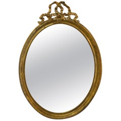 19th Century Louis XVI Style Gilded Oval Mirror, a Large Bow above the Frame