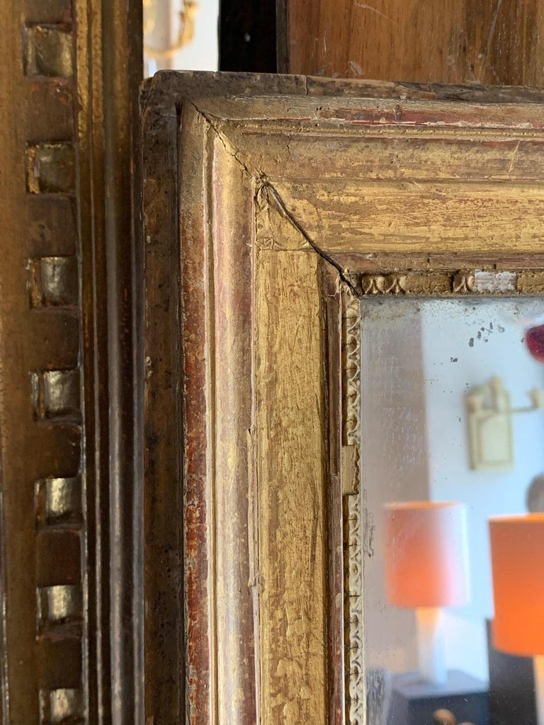 Mirror from the early 19th century in Louis XVI style, gilded wood carving, they have some small lack, but it retains its original character and patina.