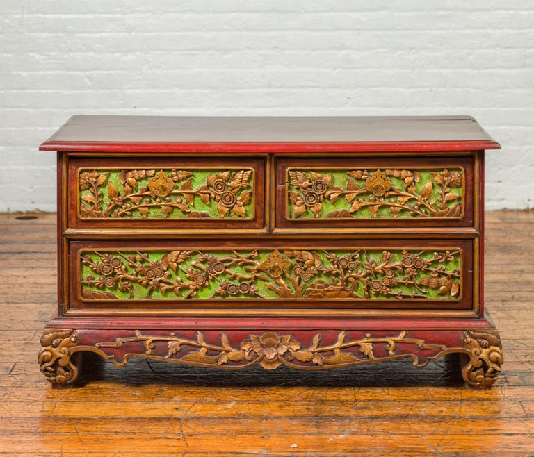 An Indonesian polychrome dresser from Madura with carved drawers and verdigris highlights. We have another dresser available that is very similar and will make for a perfect pair. See item LU863919142842. Born in Madura off of the northeastern coast