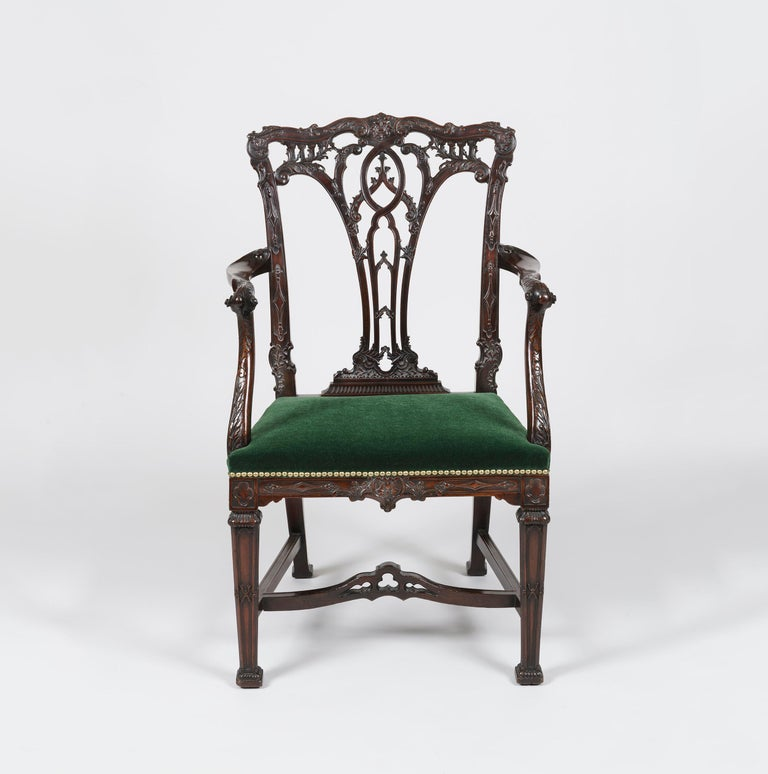 A Fine Armchair in the Manner of Thomas Chippendale  Constructed in richly coloured and crisply carved mahogany, rising from square relief-carved legs having gadrooned terminals and joined with a pierced stretcher to the sabre hind legs. The side