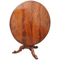 19th Century mahogany breakfast table with flame mahogany top and platform base