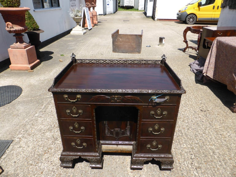 For sale is a good quality carved Chinese Chippendale style kneehole desk. The top of the desk has an intricately fretted gallery which is in perfect condition. Below this the desk has three drawers at the top, one long in the centre with one short