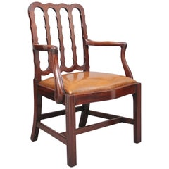 19th Century mahogany desk chair with shaped back and leather drop in seat
