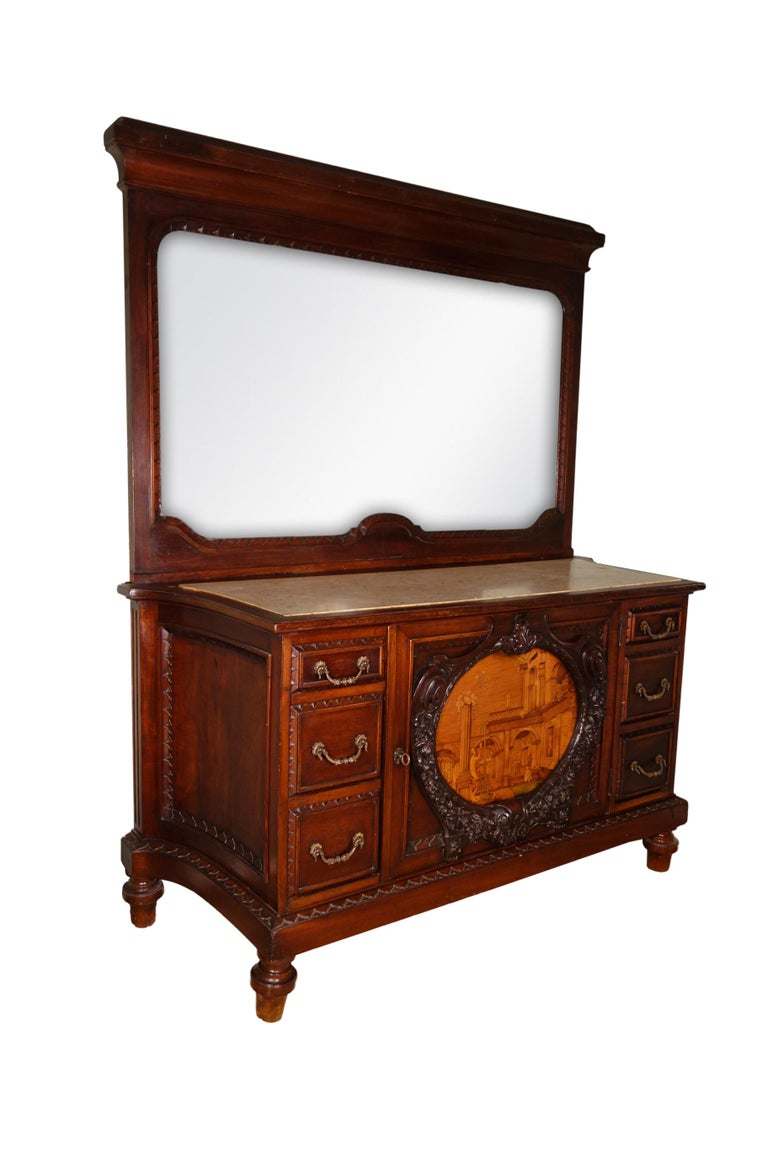 Impressive 19th century 6-drawer dresser cabinet, finely crafted of carved mahogany solids, including large older period salvage framed medallion of perspective marquetry composed in a variety of wood inlay species, attributed to the Giovanni