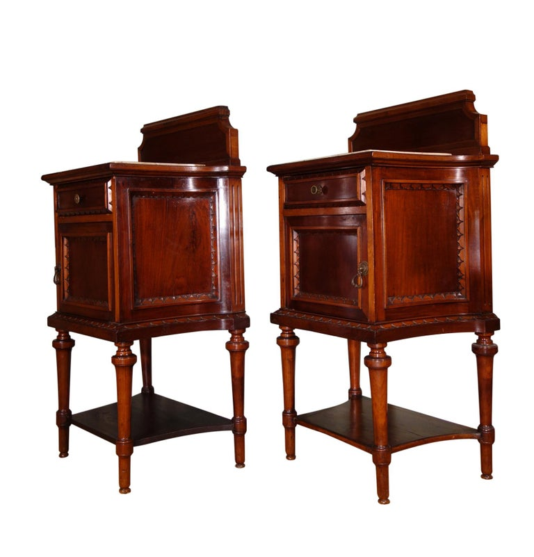 Pair of 19th century 1 drawer and 1 door nightstand tables. Likely commissioned for a noble family to accompany our separately listed King bed frame and dresser with mirror, the handcraft composition and detail is of the finest quality. Cabinet