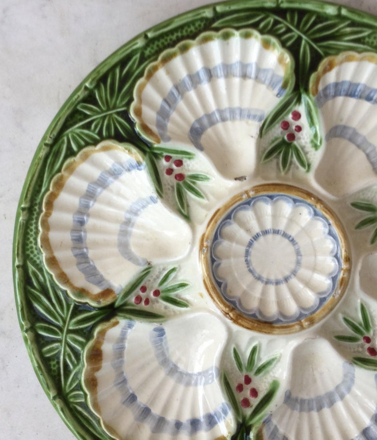 French Majolica oyster plate with bamboo patten and berries from the manufacture of Salins, circa 1890.