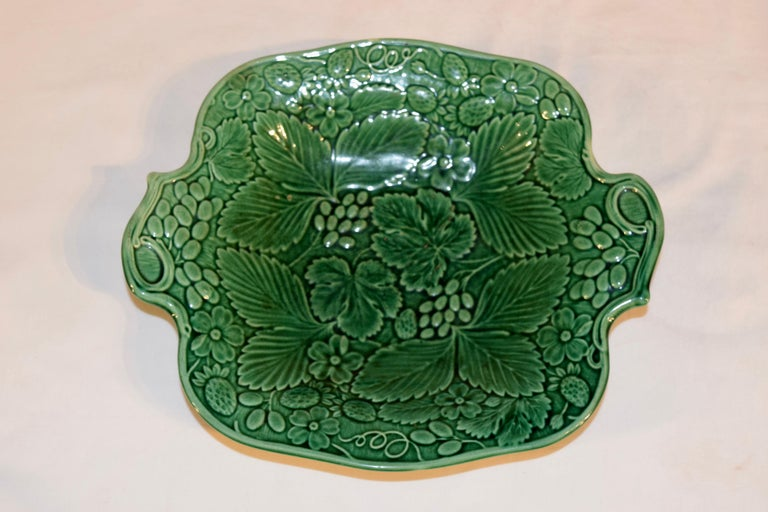 19th century English majolica handled dish with grape, leaf, and vine decorations. Normal wear and crazing for age and use.