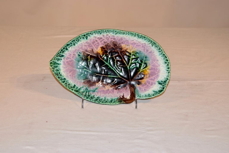 19th century Majolica leaf dish from England. The dish is molded in the shape of a leaf and then glazed very colorfully in shades of green, pink, yellow, brown and white. The leaf is wonderfully figured as well with the views of the leaf very