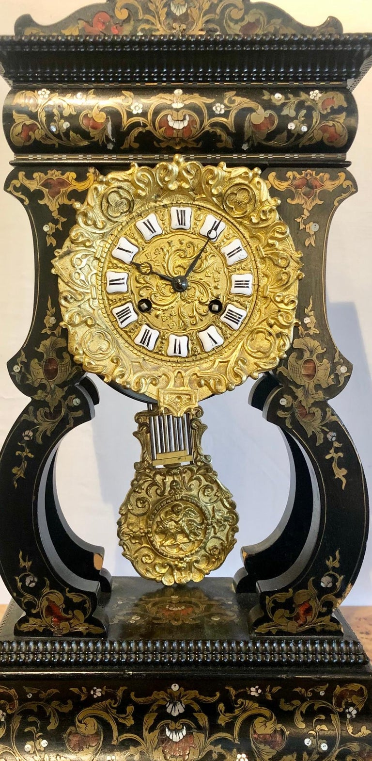 19th century mantle clock Louis Philippe ebony and boule inlaid. The fine and very decorative mantle clock has ornate bronze work with a bronze pendulum. Not working at this time. ZZL.