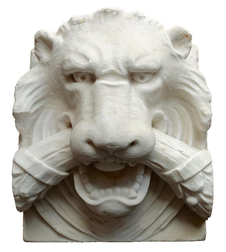 A wonderfully detailed carved white marble architectural element or sculpture of a lion head. European 19th century.