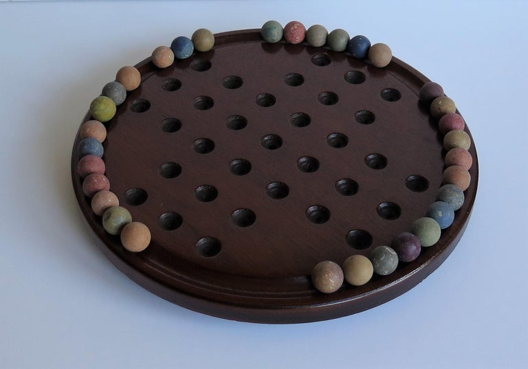 Clay 19th Century Marble Solitaire Game with Handmade Mahogany Board and 32 marbles For Sale