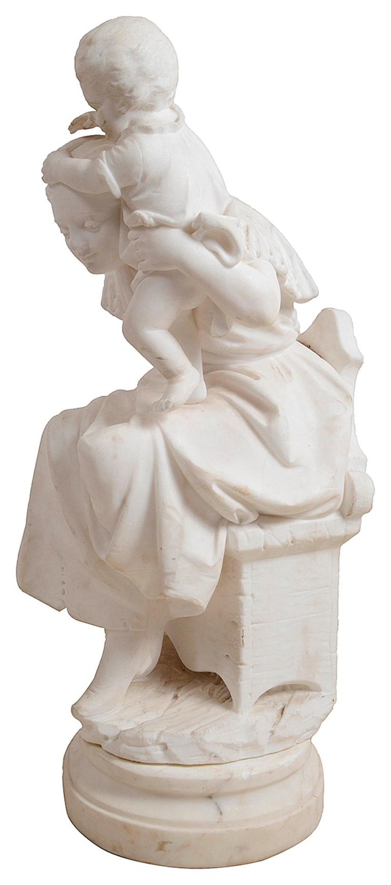 An enchanting 19th century carved marble statue of a seated mother and child playing on her shoulders.