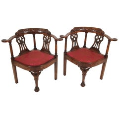 19th Century Matched Pair of Irish Carved Walnut Corner Elbow Chairs