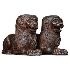 19th Century Matched Pair of Recumbent Carved Mahogany Lions