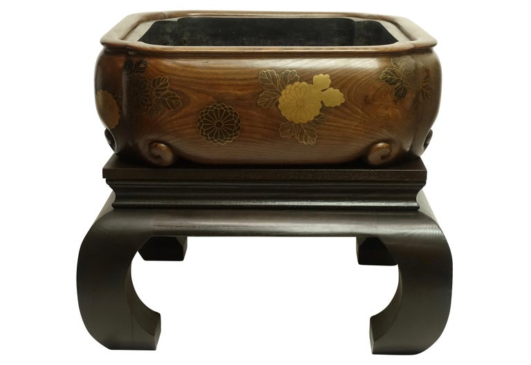 Extremely fine quality and very large size hibachi with original copper liner. Lacquer over solid chestnut with custom made stand. Japan, late 19th century.