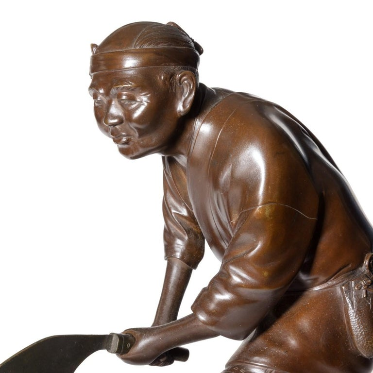 Japanese 19th Century Meiji Period Bronze of a Woodcutter Sawing a Large Tree Trunk For Sale