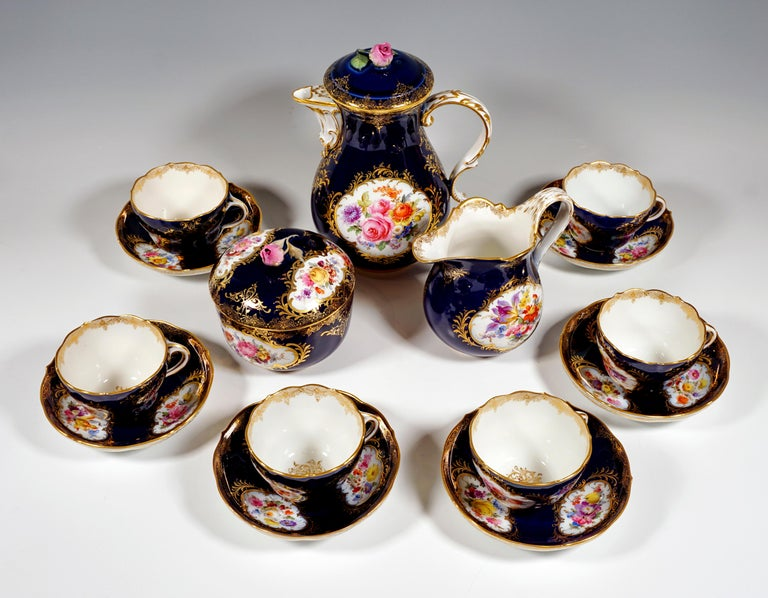 Meissen coffee service, consisting of 15 parts: coffee pot with lid, milk jug, sugar bowl, six cups and six saucers. Shape: New cutout Decor: cobalt blue, reserves filled with flower bouquets, rich gold decor - also on the inside of the cups, gold
