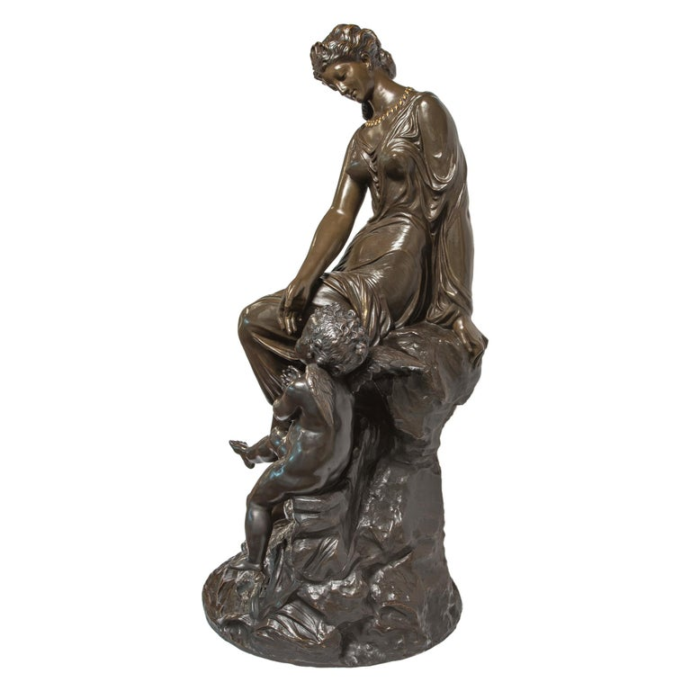 Finely casted monumental patinated bronze sculpture of Venus and Cupid attributed to Mathurin Moreau.  Artist: Attributed to Mathurin Moreau (1822-1912) Origin: French Date: Late 19th century Dimension: 38 in. x 16 1/2 in.