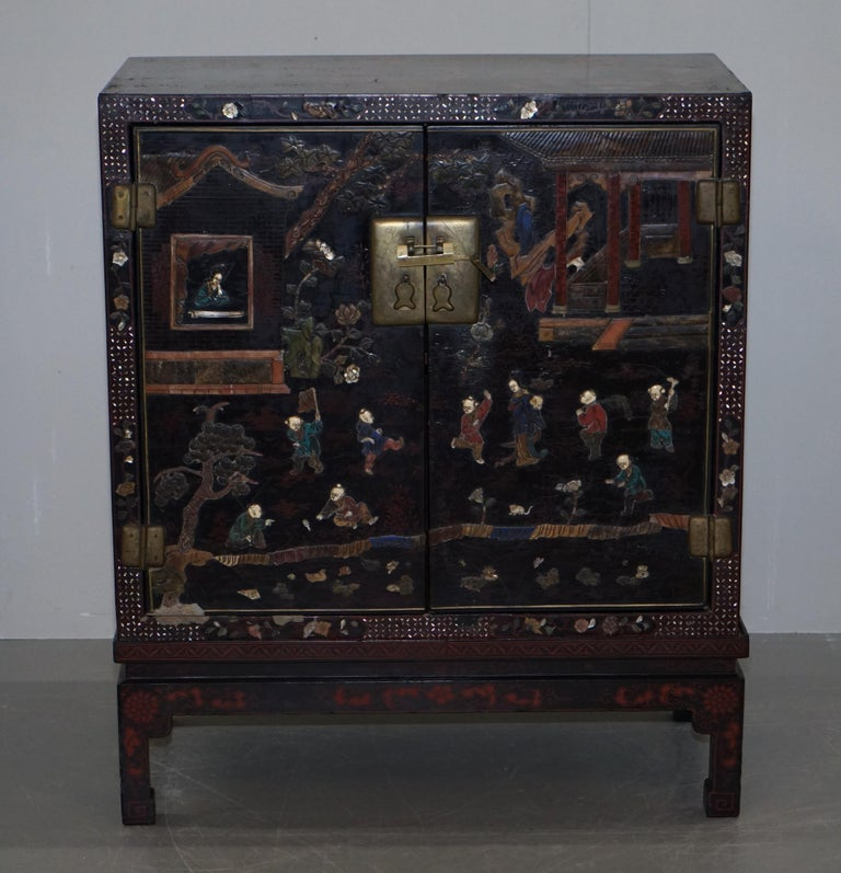 We are delighted to offer for sale this exquisite 19th century circa 1860 Chinese mother of pearl inlaid with ornately carved panels and lacquer finish cupboard  A very rare collectable and decorative cupboard on stand. This is a mid Victorian