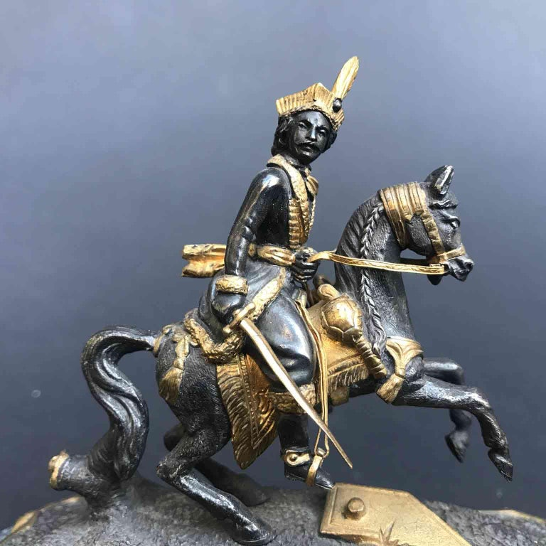 Antique French bronze knight figure,  very finely cast bronze figure of a knight on a horse, a mid-19th century Joachim Murat figure on prancing horse, mounted on a green marble shaped base, probably inspired to a famous painting and depicting the