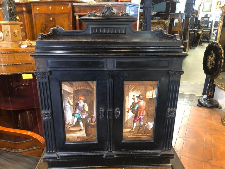 Ebonized furniture of Belgian origin, ceramic applications painted with scenes of everyday life in a Inn, Napoleon III era, circa 1850.