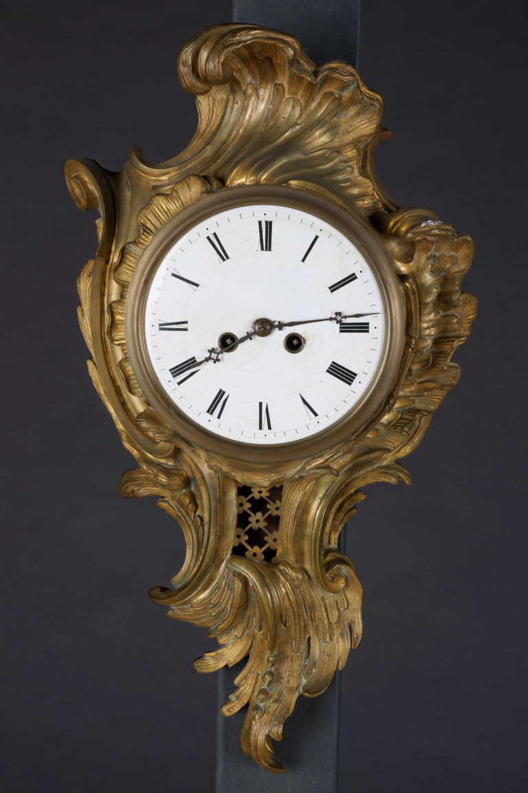French cartel clock bronze 19th century Napoleon III. Bronze case, matte gold-plated and polished. Pendulum window. Enamel dial with Arabic. Digits, week work with half-hour strike on bell.  (R-38).
