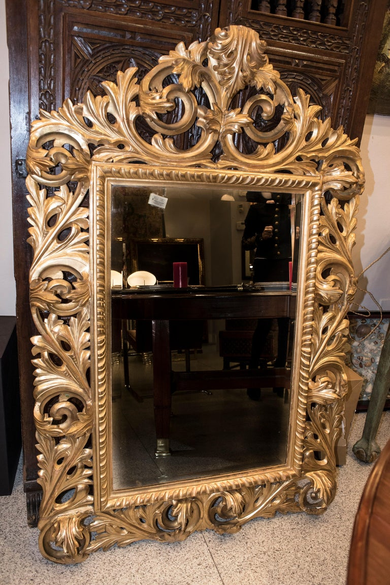Stunning Napoleon III French carved and golden wood wall mirror with Fine gold .Carved leaves and roleos surrounded the rectangular profile of this amazing and unique mirror. It has been purchased in an French inheritance Deligthful to place in an