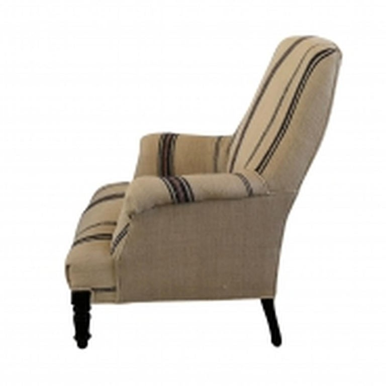 An antique Napoleon III Fauteuil, the French side chair is newly reupholstered in an antique hemp fabric, standing on four small hand carved Walnut feet, in good condition. Wear consistent with age and use, circa 1860, Paris, France.  Measures:
