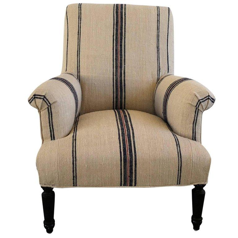 An antique Napoleon III Fauteuil, the French side chair is newly reupholstered in an antique hemp fabric, standing on four small hand carded walnut feet, in good condition. Wear consistent with age and use, circa 1860, Paris, France.  Measures: