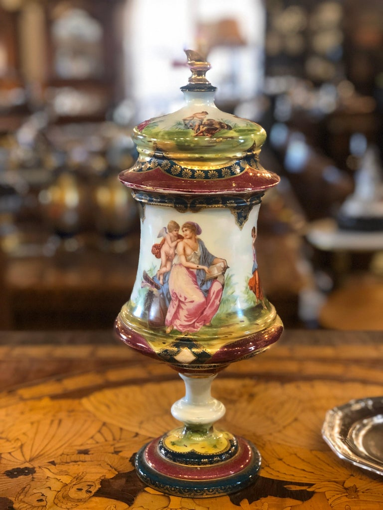 A real Vienna porcelain urn, with Classic figural scenes. Period 19th century in very good state of conservation, this is a beautiful example of fine Vienna royal porcelain.  Brand under the foot corresponding to the years 1860-1880.