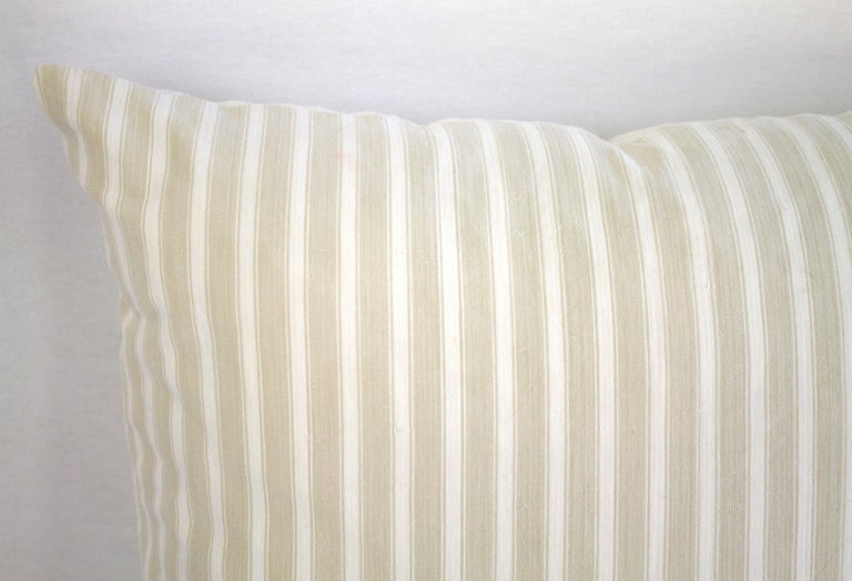 19th century natural French ticking pillow  We custom made this accent pillow from 19th & 20th century textiles. The face is a natural and creamy white ticking stripe, the back is a French homespun linen. Measures: 20x20 with hidden zipper