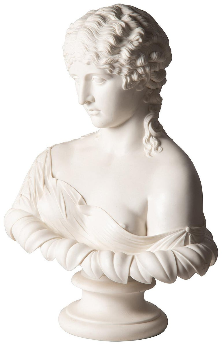A beautiful 19th century French neoclassical Parian bust of a female, semi clad and raised on a socle base.