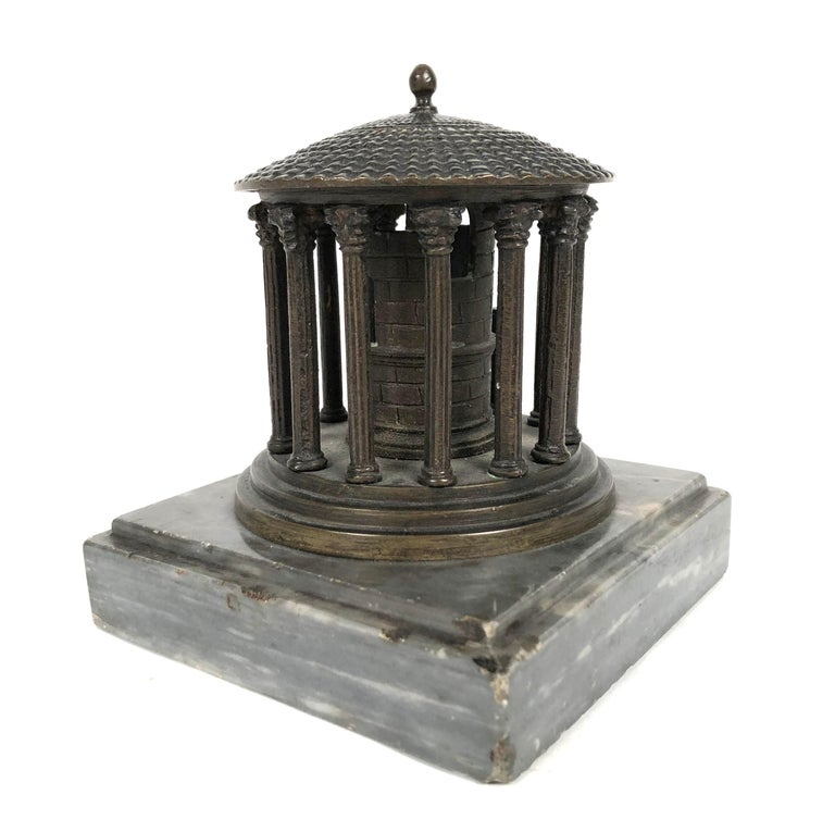 A 19th century Grand Tour neoclassical  bronze architectural model of the Temple of Vesta, Rome, circa 1875, on a square grey marble base. The primary value in going on the Grand Tour was the exposure it provided to the cultural legacy of classical