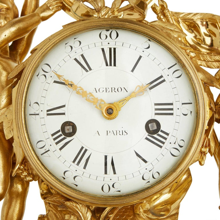 This endearing French mantel clock combines lustrous ormolu and sumptuous white marble, making for a light and yet majestic work that perfectly compliments the masterfully executed Neoclassical design. 