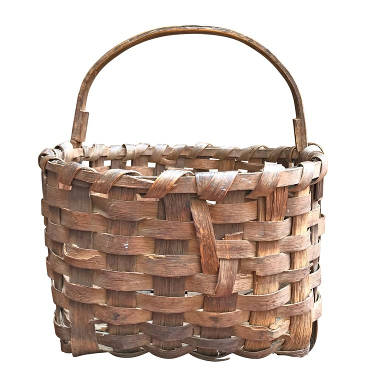 A sweet 19th century splint oak gathering basket with a single bentwood handle and a wonderful patina. Found in New England.