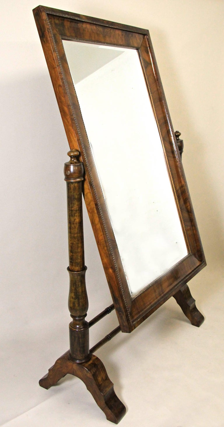 Gorgeous large 19th century nutwood Cheval mirror from the early Biedermeier era circa 1825 in Vienna/ Austria, one of the world's epicenter of this famous period. Impressing with its dreamlike original condition - only the facet-cut mirror had to