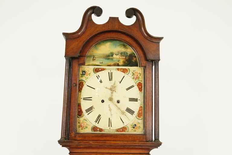 Antique 19th century oak longcase grandfather clock 8 day works, Scotland 1850, B1711  Scotland 1850 Oak construction Swan neck pediment Lovely decorated arched painted dial Has wear on face 8 Day movement striking the hour on a bell Lovely