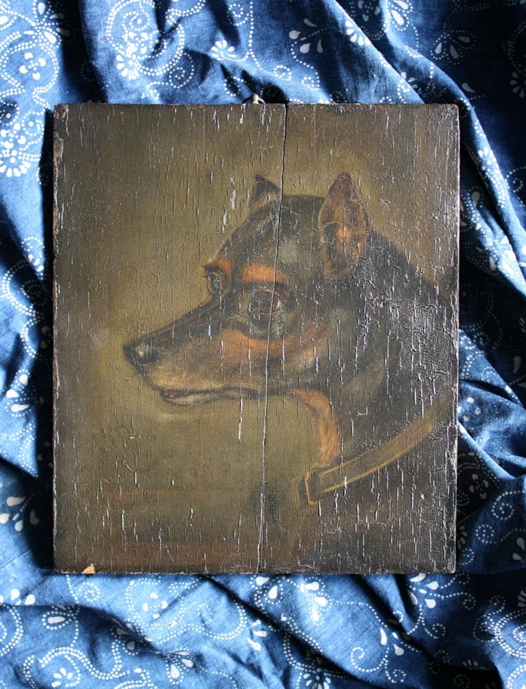 An imposing dark and moody depiction of A English Toy Terrier, oil on board.   The painted surface has a decorative texture, some minor losses. An elderly spilt in the board has been repaired (two wooden straps on back),  circa 1880, measures: