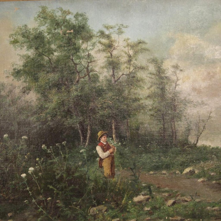 French painting from the second half of the 19th century. Oil painting on canvas depicting a woodland landscape with a child signed on the lower right signature in the study phase. Framework of pleasant decor complete with gilded wooden frame from