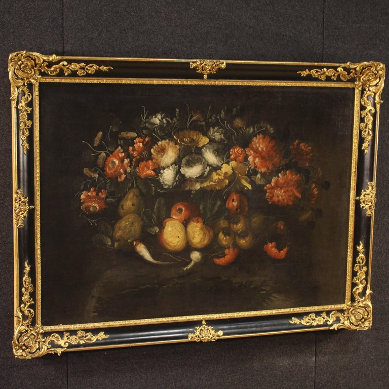 French painting from the late 19th century, early 20th century. Oil painting on canvas depicting rich still life with flowers and fruit on a dark background. Framework of good pictorial quality, for antique dealers and collectors, of beautiful size