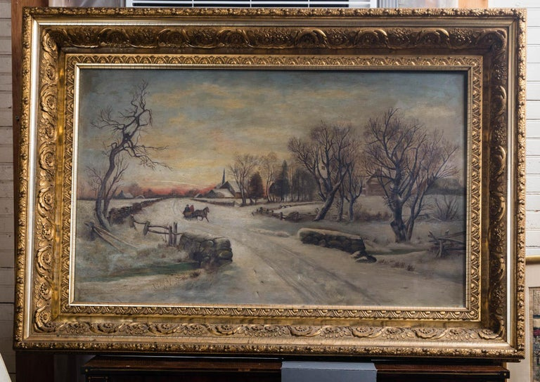 Two figures in a horse drawn sleigh, on a cold snow covered day. They have passed a farm and a church along the country road, approaching a stone bridge.