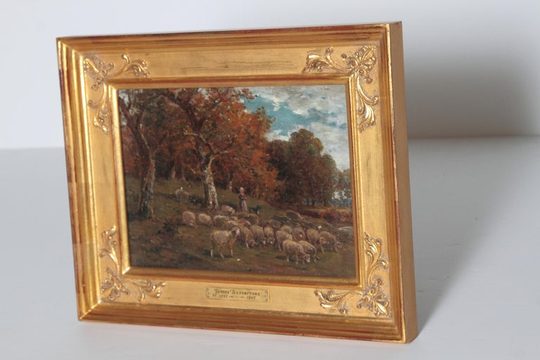 19th century oil on canvas by James Desvarreux-Larpenteur (1847-1937, American). Depicting a Shepherdess and her sheep dog tending a flock of sheep near a Stand of trees on a sunny day. Signed J Desvarruex lower left. He studied in Paris at the