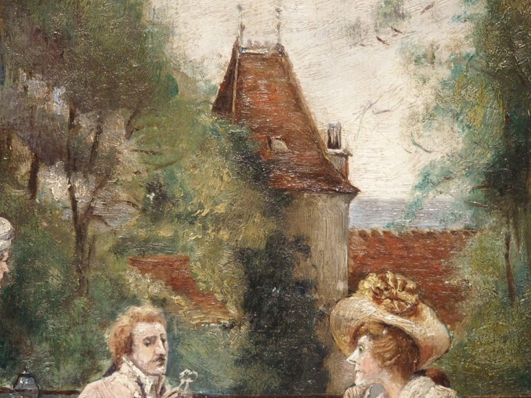 This charming gilt framed oil painting on board depicts a couple dining on a restaurant's outside terrace, with the waiter standing beside them. The scene takes place at the end of the meal, as the gentleman has his spectacles out and is reading the